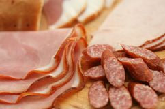 Cold cuts. Close-up of cold cuts on wood plate Stock Photos