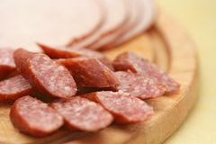 Cold cuts. Close-up of cold cuts on wood plate Royalty Free Stock Photography