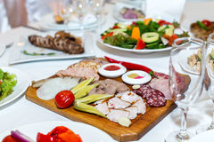 Cold cuts on a banquet table Stock Images