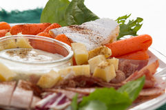 Cold Cuts and Cheese Snack Time. Cold cuts, cheese and dip for mid day snack Stock Photo