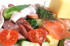 Cold cuts, fish, vegetables and cheese Royalty Free Stock Image