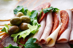 Cold cuts with olives Stock Images