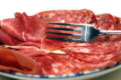 Cold Cuts Plate of Salami and Prosciutto with Fork Stock Photos