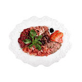 Cold cuts, on a plate (white background). Cold cuts, on a plate white background Stock Photos