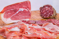 Cold cuts. Platter of cold cuts on wooden table stock photo