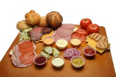 Cold Cuts and Rolls on Cutting Board stock photography