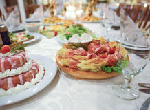 Cold cuts on a well decorated table stock photos