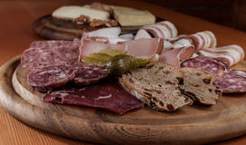 Cold Cuts on a wooden Chopping Board Stock Photo