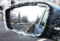 Cold day in bucharest romania. Empty road. Ice on car mirror stock images