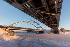 Cold day underneath a railroad bridge. Low midwinter sun lights the underside of a railroad bridge on an extremely cold December day in Northern Finland Stock Photography