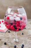 Cold delicious juice made of raspberries and chokeberries Royalty Free Stock Photo