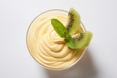 Cold dessert decorated with slices of kiwi Royalty Free Stock Photos