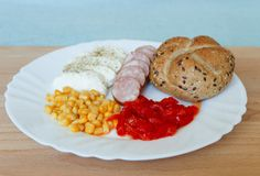 Cold dinner. Taken May 22, 2016 Jablonec nad Nisou Czech Republic cold supper on white plate mozzarella sliced sausage with bun corn and pickled peppers Royalty Free Stock Image