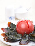 Cold dish - century eggs. Chinese cold dish - century eggs and tomato Stock Photo