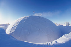 Cold Dome. The South Pole Dome covered in frost from the long cold winter. The Dome was built by the US Navy Seabees and commission in 1975 and replaced by the Stock Photo