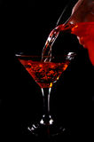 Cold drink. Pouring an ice cold drink into a glass royalty free stock photos