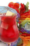 Cold Drink. Red refreshing cold drink on a colorful background Royalty Free Stock Photos