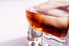 Cold drink. Coke on rocks royalty free stock image