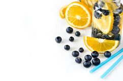 Cold drink with fresh berries and orange on white background. Lemonade with fruits, copyspace background Stock Photo