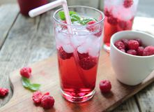 Cold drink with fresh rasberries fruits Royalty Free Stock Photography