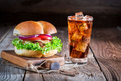 Cold drink with homemade burger Royalty Free Stock Photos