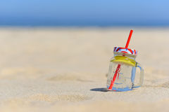Cold drink in jar on the beachwith copy space. Stock Photos