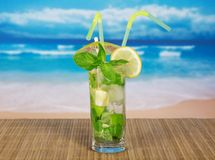 Cold drink with lemon slice and spearmint Stock Photos