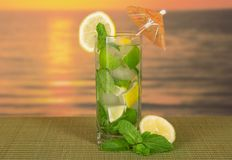 Cold drink with a lemon slice Royalty Free Stock Images