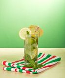 Cold drink with lemon slice, spearmint Stock Images
