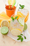 Cold drink with lemons and oranges Stock Photography