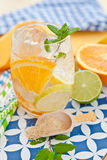 Cold drink with lemons and oranges Royalty Free Stock Photo