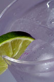 Cold Drink with Lime 2. Ice cold beverage with lime royalty free stock photography