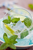 Cold drink with lime and ice Royalty Free Stock Image