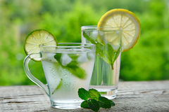 A cold drink made of lemon, lime. And mint  outdors Royalty Free Stock Photo