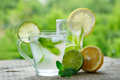 A cold drink made of lemon, lime. And mint outdors Stock Images