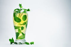 Cold drink with mint and ice. In a glass Royalty Free Stock Photos