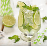 Cold drink with mint and lime Royalty Free Stock Image