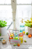 Cold drink with orange and lemon Stock Photos