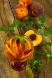 Cold drink with peaches Royalty Free Stock Photo
