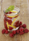 Cold drink with raspberries Royalty Free Stock Image