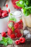 Cold drink - raspberries summer refreshing cocktail. Stock Photos