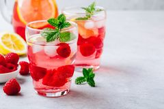Cold drink Raspberry Lemonade with mint in glass. Refreshing summer cocktail. Cold drink Raspberry Lemonade with mint in glass Royalty Free Stock Images
