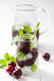 Cold drink with straw - cherry refreshing cocktail. Royalty Free Stock Image