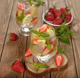 Cold drink with strawberries, lemon and mint Stock Photography
