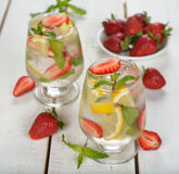 Cold drink with strawberries, lemon and mint Stock Photo