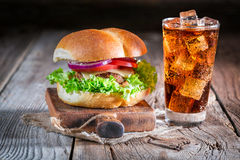 Cold drink with tasty burger Royalty Free Stock Images