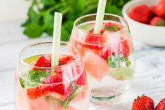 Cold drink with watermelon, strawberry, balm mint. Close up Stock Images