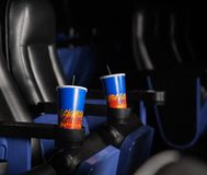 Cold Drinks In Armrests Of Seats At Theater Royalty Free Stock Photos