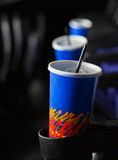 Cold Drinks In Armrests At Theater Stock Image