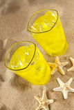 Cold drinks on the beach Stock Images